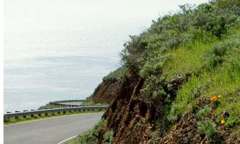 The steep winding road along the Marin Headlands with view of Pacific Ocean